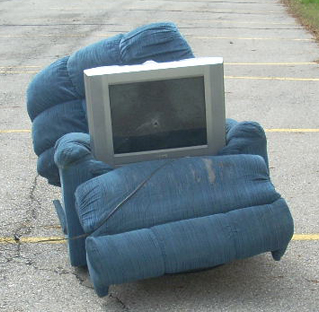 easy-chair-and-tv-with-bullet-hole-1