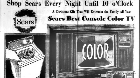 The ad is black and whte, but the big console TV is COLOR from Sears.